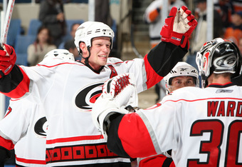 UNIONDALE, NY - OCTOBER 25: Eric Staal #12 and Cam Ward #30 of the Carolina Hurricanes celebrate after defeating the New York Islanders on October 25, 2008 at the Nassau Veterans Memorial Coliseum in Uniondale, New York. The Hurricanes defeated the Island