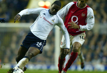 LONDON - DECEMBER 15:  Thierry Henry of Arsenal tries to tackle Ledley King of Tottenham Hotspur during the FA Barclaycard Premiership match between Tottenham Hotspur and Arsenal at White Hart Lane, London on December 15, 2002. (Photo by Ben Radford/Getty