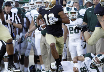 SOUTH BEND, IN - SEPTEMBER 17: Robert Blanton of the Notre Dame Fighting Irish returns an interception 82-yards while playing the Michigan State Spartans during the second half September 17, 2011at Notre Dame Stadium in South Bend, Indiana. Notre Dame def