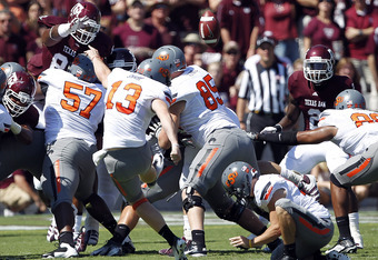 COLLEGE STATION, TX - SEPTEMBER 24:  Kicker Quin Sharp #13 of Oklahoma State Cowboys kicks a field goal against Texas A&M Aggies at Kyle Field on September 24, 2011 in College Station, Texas.  (Photo by Bob Levey/Getty Images)