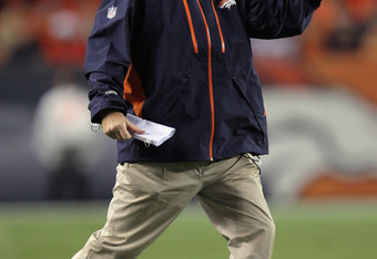 DENVER, CO - SEPTEMBER 12:  Head coach John Fox of the Denver Broncos leads his team against the Oakland Raiders at Sports Authority Field at Mile High on September 12, 2011 in Denver, Colorado. The Raiders defeated the Broncos 23-20.  (Photo by Doug Pens