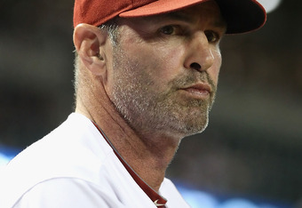 PHOENIX, AZ - SEPTEMBER 26:  Manager Kirk Gibson of the Arizona Diamondbacks watches from the dugout during the Major League Baseball game against the Los Angeles Dodgers at Chase Field on September 26, 2011 in Phoenix, Arizona.  The Dodgers defeated the