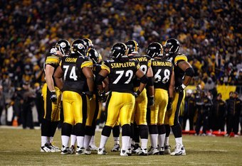 PITTSBURGH - JANUARY 11:  (L-R) Heath Miller #83, Willie Colon #74, Darnell Stapleton #72, Justin Hartwig #62, Chris Kemoeatu #68 and Max Starks #78 of the Pittsburgh Steelers stand in the offensive huddle against the San Diego Chargers during their AFC D
