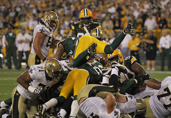 GREEN BAY, WI - SEPTEMBER 08:  Members of the Green Bay Packer defense stop the New Orleans Saints short of the goal on the final play of the game during the NFL opening season game at Lambeau Field on September 8, 2011 in Green Bay, Wisconsin. The Packer
