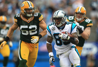 CHARLOTTE, NC - SEPTEMBER 18:  Steve Smith #89 of the Carolina Panthers runs away from  Clay Matthews #52 of the Green Bay Packers during their game at Bank of America Stadium on September 18, 2011 in Charlotte, North Carolina.  (Photo by Streeter Lecka/G