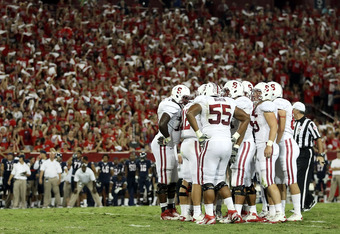 TUCSON, AZ - SEPTEMBER 17:  The Stanford Cardinal huddle up during the college football game against the Arizona Wildcats at Arizona Stadium on September 17, 2011 in Tucson, Arizona. The Cardinal defeated the Wildcats 37-10.  (Photo by Christian Petersen/