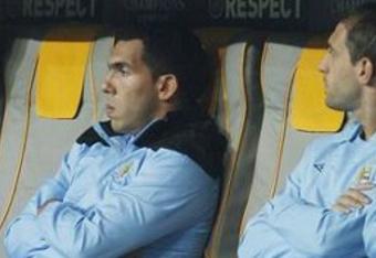 Empty seats next to a friendless Tevez