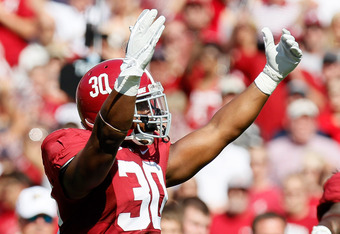 TUSCALOOSA, AL - SEPTEMBER 24:  Dont'a Hightower #30 of the Alabama Crimson Tide tries to pump up the crowd against the Arkansas Razorbacks at Bryant-Denny Stadium on September 24, 2011 in Tuscaloosa, Alabama.  (Photo by Kevin C. Cox/Getty Images)