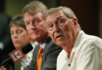 AUSTIN, TX - JUNE 15:  University of Texas at Austin Men's Athletics Director DeLoss Dodds, right, University President William Powers Jr., center, and Women's Athletics Director Chris Plonskon announce the athletics programs will continue competing in th