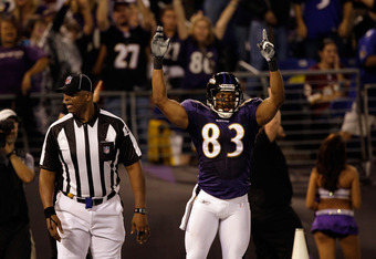 BALTIMORE, MD - AUGUST 25:  Wide receiver Lee Evans #83 of the Baltimore Ravens celebrates after scoring a touchdown against the Washington Redskins during the first half of a preseason game at M&T Bank Stadium on August 25, 2011 in Baltimore, Maryland.