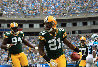 CHARLOTTE, NC - SEPTEMBER 18:   Charles Woodson #21 of the Green Bay Packers celebrates after recovering a fumble against the Carolina Panthers during their game at Bank of America Stadium on September 18, 2011 in Charlotte, North Carolina.  (Photo by Str