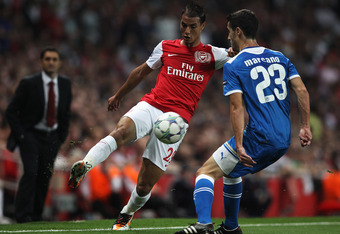 LONDON, ENGLAND - SEPTEMBER 28:  Marouane Chamakh of Arsenal  takes on Ivan Marcano of Olympiacos during the UEFA Champions League Group F match between Arsenal and Olympiacos at the Emirates Stadium on September 28, 2011 in London, England.  (Photo by Cl