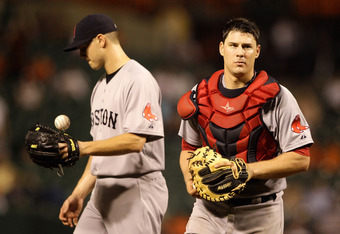 BALTIMORE, MD - SEPTEMBER 27: Catcher Ryan Lavarnway #60 of the Boston Red Sox walks away from the mound after talking with relief pitcher Jonathan Papelbon #58 during the ninth inning against the Baltimore Orioles at Oriole Park at Camden Yards on Septem