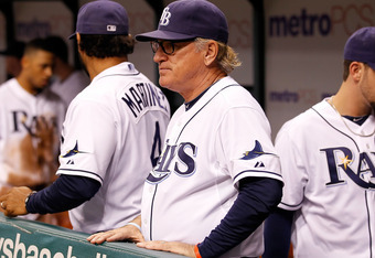 ST. PETERSBURG, FL - SEPTEMBER 23:  Manager Joe Maddon #70 of the Tampa Bay Rays directs his team against the Toronto Blue Jays during the game at Tropicana Field on September 23, 2011 in St. Petersburg, Florida.  (Photo by J. Meric/Getty Images)