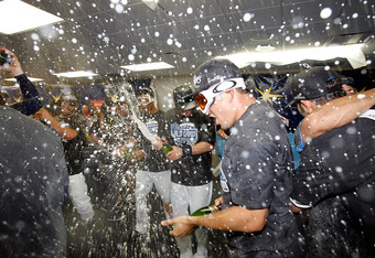 ST PETERSBURG, FL - SEPTEMBER 28:  The Tampa Bay Rays celebrate a victory over the New York Yankees at Tropicana Field on September 28, 2011 in St. Petersburg, Florida.  (Photo by J. Meric/Getty Images)