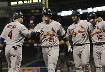 HOUSTON - SEPTEMBER 27:  Allen Craig #21 of the St. Louis Cardinals receives congratulations from Yadier Molina #4 after hitting a three run home run in the eighth inning scoring Albert Pujols #5 and Lance Berkman #12 at Minute Maid Park on September 27,