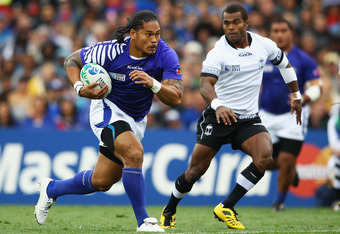 AUCKLAND, NEW ZEALAND - SEPTEMBER 25:  Alesana Tuilagi of Samoa charges forward during the IRB 2011 Rugby World Cup Pool D match between Fiji and Samoa at Eden Park on September 25, 2011 in Auckland, New Zealand.  (Photo by Hannah Johnston/Getty Images)