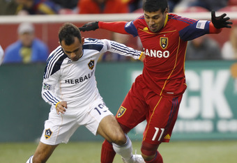 SANDY, UT - MARCH 26: Javier Morales #11 of Real Salt Lake and Juninho #19 of Los Angeles Galaxy fight for the ball during the first half of an MLS soccer game March 26, 2011 at Rio Tinto Stadium in Sandy, Utah. (Photo by George Frey/Getty Images)