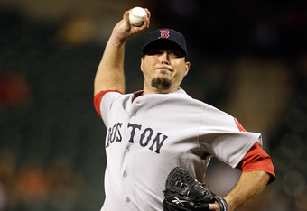 BALTIMORE, MD - SEPTEMBER 26:  Starting pitcher Josh Beckett #19 of the Boston Red Sox throws to a Baltimore Orioles batter during the first inning at Oriole Park at Camden Yards on September 26, 2011 in Baltimore, Maryland.  (Photo by Rob Carr/Getty Imag