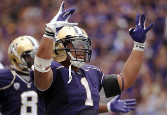 SEATTLE, WA - SEPTEMBER 24:  Chris Polk #1 of the Washington Huskies celebrates a 31-23 lead over the California Golden Bears in the last minute of the game at Husky Stadium on September 24, 2011 in Seattle, Washington.  (Photo by Harry How/Getty Images)