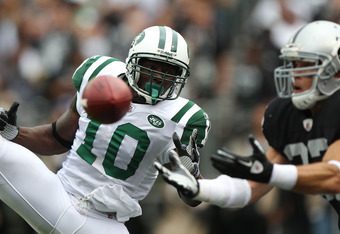 OAKLAND, CA - SEPTEMBER 25:  Santonio Holmes #10 of the New York Jets misses a pass as Matt Giordano #27 of the Oakland Raiders defends at O.co Coliseum on September 25, 2011 in Oakland, California.  (Photo by Jed Jacobsohn/Getty Images)