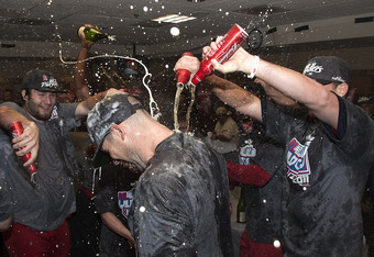 HOUSTON - SEPTEMBER 28:  Pitcher Chris Carpenter (C) of the St. Louis Cardinals is showered with beer as they celebrate winning the National League wild card at Minute Maid Park on September 28, 2011 in Houston, Texas.  (Photo by Bob Levey/Getty Images)