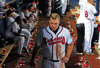 ATLANTA - SEPTEMBER 28: Chipper Jones #10 of the Atlanta Braves paces the dugout after striking out in the 13th inning against the Philadelphia Phillies at Turner Field on September 28, 2011 in Atlanta, Georgia. (Photo by Scott Cunningham/Getty Images)
