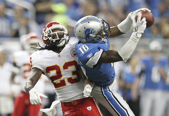 DETROIT, MI - SEPTEMBER 18:  Titus Young #16 of the Detroit Lions catches a 43 yard pass in the second quarter from Matthew Stafford #9 as Brandon Flowers #24 of the Kansas City Chiefs defends at Ford Field on September 18, 2011 in Detroit, Michigan.  (Ph