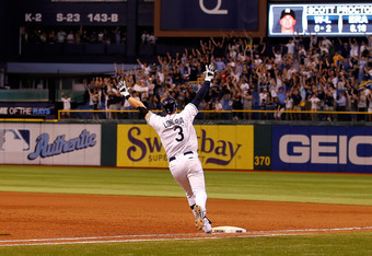 ST. PETERSBURG, FL - SEPTEMBER 28:  Evan Longoria #3 of the Tampa Bay Rays rounds the bases after his game-winning walk off home run in the twelfth inning against the New York Yankees during the game at Tropicana Field on September 28, 2011 in St. Petersb