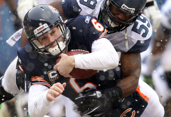 CHICAGO, IL - JANUARY 16:  Quarterback Jay Cutler #6 of the Chicago Bears dives into the endzone to score on a six-yard run against Aaron Curry #59 of the Seattle Seahawks in the second quarter of the 2011 NFC divisional playoff game at Soldier Field on J