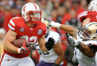 LINCOLN, NE - SEPTEMBER 17: Rex Burkhead #22 of the Nebraska Cornhuskers runs past Talia Crichton #11 of the Washington Huskies during their game at Memorial Stadium September 17, 2011 in Lincoln, Nebraska. Nebraska won 51-38.(Photo by Eric Francis/Getty