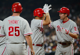 ATLANTA - SEPTEMBER 9:  Tomas Perez #9 of the Philadelphia Phillies is congratulated by Chase Utley #26 after hitting a grand slam (third home run of the season) off of pitcher Trey Hodges #45 of the Atlanta Braves in the second inning of the game on Sept
