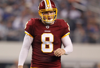 ARLINGTON, TX - SEPTEMBER 26:  Rex Grossman #8 of the Washington Redskins stands on the field against the Dallas Cowboys during their game at Cowboys Stadium on September 26, 2011 in Arlington, Texas.  (Photo by Tom Pennington/Getty Images)