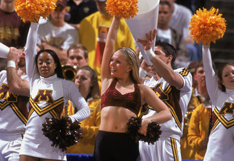 08 Mar 2002:  The Minnesota Golden Gophers cheerleaders try to pump up the crowd during game seven of the BIG 10 Tournament against the Illinois Fighting Illini at the Conseco Fieldhouse in Indianapolis, Indiana. The Fighting Illini defeated the Golden Go