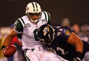 EAST RUTHERFORD, NJ - SEPTEMBER 13:  Mark Sanchez #6 of the New York Jets gets sacked by Haloti Ngata #92 of the Baltimore Ravens during their home opener at the New Meadowlands Stadium on September 13, 2010 in East Rutherford, New Jersey.  (Photo by Andr