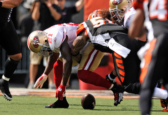 CINCINNATI, OH - SEPTEMBER 25:  Frank Gore #21 of the San Francisco 49ers fumbles the ball as he is hit by Rey Maualuga #58 of the Cincinnati Bengals at Paul Brown Stadium on September 25, 2011 in Cincinnati, Ohio. The Bengals recovered and added a field
