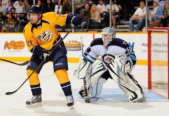 NASHVILLE, TN - SEPTEMBER 24:  Patric Hornqvist #27 of the Nashville Predators skates in front of goalie Chris Mason #50 of the Winnipeg Jets at Bridgestone Arena on September 24, 2011 in Nashville, Tennessee.  (Photo by Frederick Breedon/Getty Images)