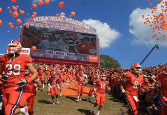 CLEMSON, SC - SEPTEMBER 24:  The Clemson Tigers run onto the field before their game against the Florida State Seminoles at Memorial Stadium on September 24, 2011 in Clemson, South Carolina.  (Photo by Streeter Lecka/Getty Images)