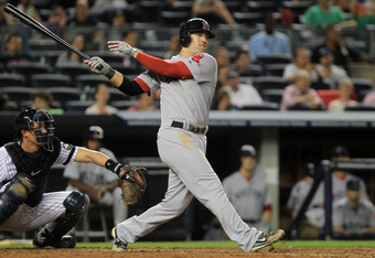 NEW YORK - SEPTEMBER 25: Ryan Kalish #55 of the Boston Red Sox hits a double to get team mate Yamaico Navarro #56 home against the New York Yankees during their game on September 25, 2010 at Yankee Stadium in the Bronx borough of New York City.  (Photo by