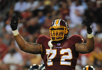 LANDOVER, MD - AUGUST 12:  Stephen Bowen #72 of the Washington Redskins celebrates a play against the Pittsburgh Steelers  at FedExField on August 12, 2011 in Landover, Maryland. The Redskins are tied with the Steelers 7-7 at the half. (Photo by Larry Fre