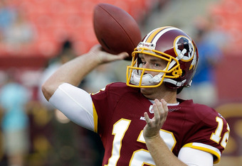 LANDOVER, MD - SEPTEMBER 01:  Quarterback  John Beck #12 of the Washington Redskins warms up before the start of a preseason game against the Tampa Bay Buccaneers at FedExField on September 1, 2011 in Landover, Maryland.  (Photo by Rob Carr/Getty Images)