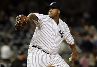 NEW YORK, NY - SEPTEMBER 21:  CC Sabathia #52 of the New York Yankees pitches against the Tampa Bay Rays on September 21, 2011 at Yankee Stadium in the Bronx borough of New York City.  (Photo by Jim McIsaac/Getty Images)