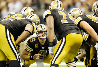NEW ORLEANS, LA - SEPTEMBER 25:  Drew Brees #9 of the New Orleans Saints calls a play during a game being held at the Louisiana Superdome on September 25, 2011 in New Orleans, Louisiana. The Saints defeated the Texans 40-33. (Photo by Stacy Revere/Getty I