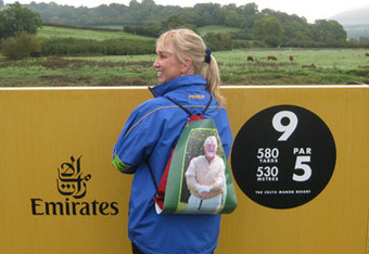 Faith Tanner with photo of her late husband Larry on backpack