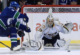 VANCOUVER, CANADA - APRIL 30: Henrik Sedin #33 of the Vancouver Canucks watches his puck slide wide past goalie Pekka Rinne #35 of the Nashville Predators during the first period in Game Two of the Western Conference Semifinals during the 2011 NHL Stanley