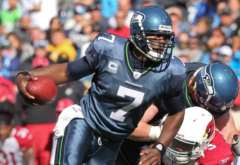SEATTLE, WA - SEPTEMBER 25:  Quarterback Tarvaris Jackson #7 of the Seattle Seahawks rushes for a touchdown against David Carter #79 of the Arizona Cardinals at CenturyLink Field on September 25, 2011 in Seattle, Washington. The Seahawks defeated the Card