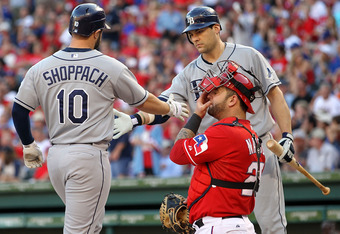 After Kelly Shoppach's second home run, Ranger catcher Mike Napoli realizes he can't compete with destiny