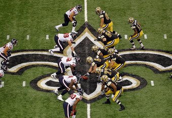 NEW ORLEANS, LA - SEPTEMBER 25:     Drew Brees #9 of the New Orleans Saints looks to throw the ball during the game against the Houston Texans at Louisiana Superdome on September 25, 2011 in New Orleans, Louisiana.  (Photo by Chris Graythen/Getty Images)