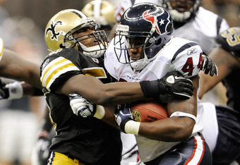 NEW ORLEANS, LA - SEPTEMBER 25:  Jo-Lonn Dunbar #56 of the New Orleans Saints brings down Ben Tate #44 of the Houston Texans during a game being held at the Louisiana Superdome on September 25, 2011 in New Orleans, Louisiana.  The Saints defeated the Texa