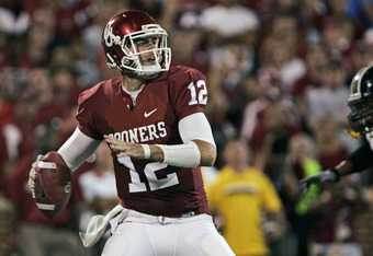 NORMAN, OK - SEPTEMBER 24:  Quarterback Landry Jones #12 of the Oklahoma Sooners looks to throw during the first half of the game against the Missouri Tigers on September 24, 2011 at Gaylord Family-Oklahoma Memorial Stadium in Norman, Oklahoma.  Oklahoma